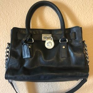 Black small leather Michael Kors lock handbag